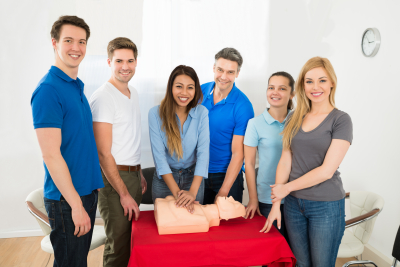 group of students and a teacher having a class about CPR